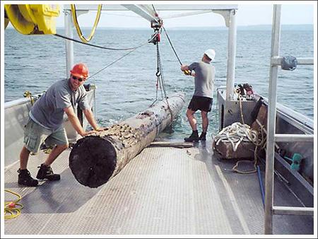 Topside: Loggers load log onto boat